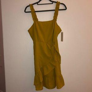 Muted yellow wrap dress w/ ruffles